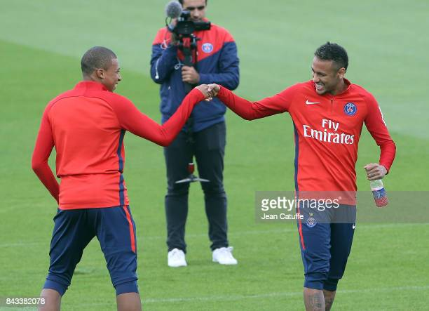Kylian Mbappe and Neymar Jr greet each other during Paris Saint Germain training session at Centre Ooredoo training camp on September 6 2017 in...