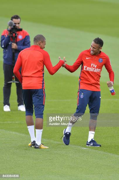 Kylian Mbappe and Neymar Jr of Paris SaintGermain shake hands before a Paris SaintGermain training session at Centre Ooredoo on September 6 2017 in...