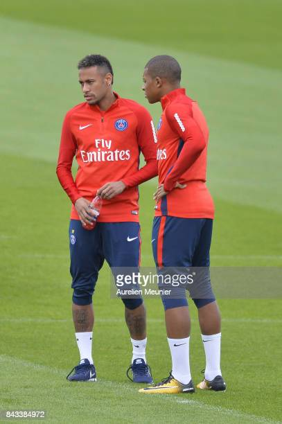 Kylian Mbappe and Neymar Jr of Paris SaintGermain speak before a Paris SaintGermain training session at Centre Ooredoo on September 6 2017 in...