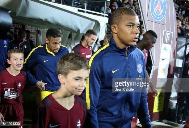 Kylian Mbappe and Neymar Jr of PSG enter the pitch prior to the French Ligue 1 match between FC Metz and Paris Saint Germain at Stade SaintSymphorien...