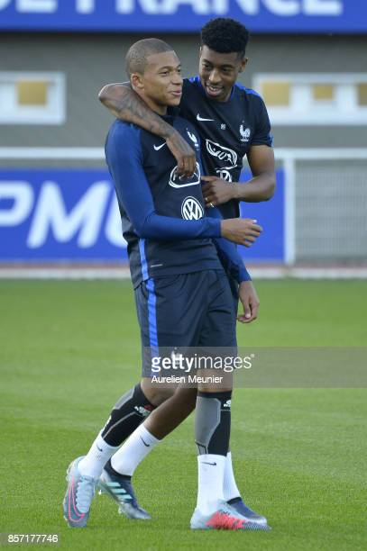 Kylian Mbappe and Presnel Kimpembe of France react during a France training session on October 3 2017 in Clairefontaine France