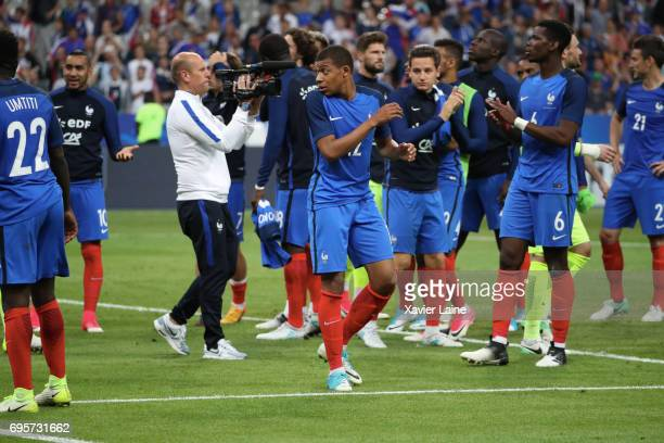 Kylian Mbappe celebrate the victory with teammattes during the International Friendly match between France and England at Stade de France on June 13...