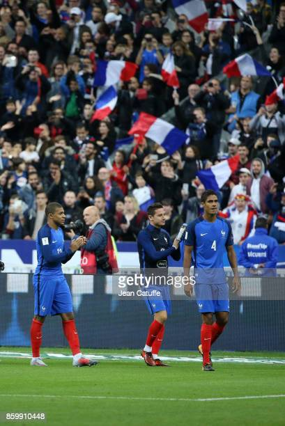 Kylian Mbappe Florian Thauvin Raphael Varane of France celebrate the qualification for Russia 2018 following the FIFA 2018 World Cup Qualifier...