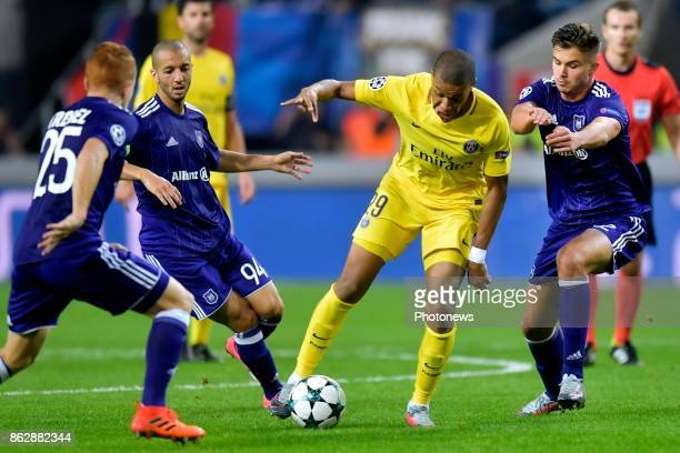 Kylian Mbappe forward of PSG battles for the ball with Leander Dendoncker midfielder of RSC Anderlecht Sofiane Hanni midfielder of RSC Anderlecht and...