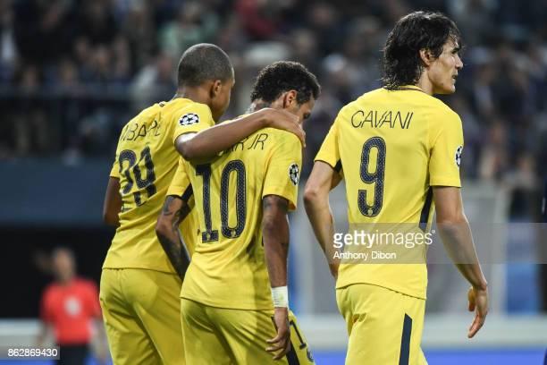 Kylian Mbappe Neymar Jr and Edinson Cavani of PSG celebrates a goal during the UEFA Champions League match between RSC Anderlecht and Paris...