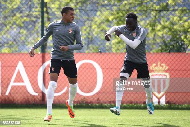 Kylian Mbappe of AS Monaco and Benjamin Mendy of AS Monaco jog during the AS Monaco training session at the La Turbie training centre on April 18...