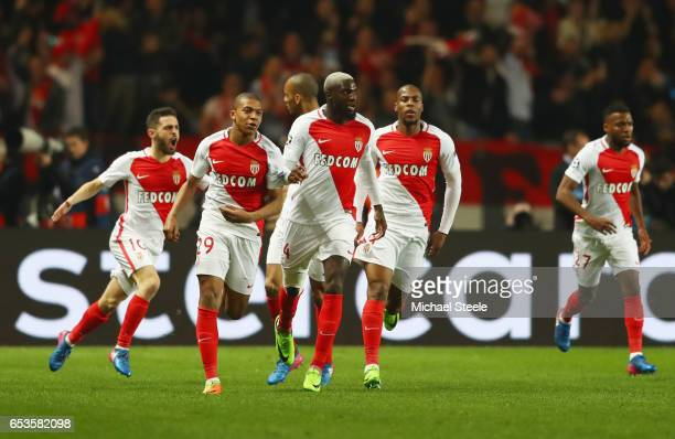 Kylian Mbappe of AS Monaco celebrates as he scores their first goal with team mates during the UEFA Champions League Round of 16 second leg match...