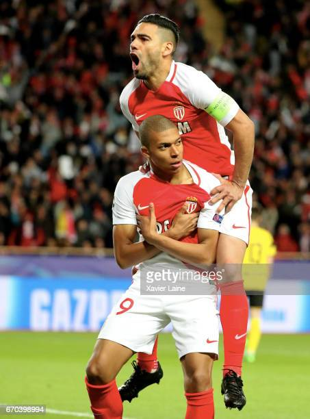 Kylian Mbappe of AS Monaco celebrates his goal with captain Radamel Falcao during the UEFA Champions League Quarter Final second leg between AS...