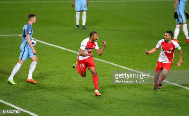 Kylian Mbappe of AS Monaco celebrates with Radamel Falcao after scoring their second goal during the UEFA Champions League Round of 16 first leg...