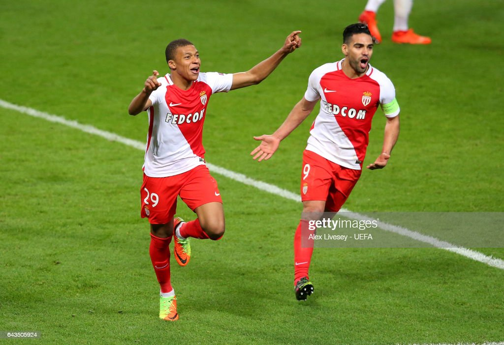 Kylian Mbappe of AS Monaco celebrates with Radamel Falcao after scoring their second goal during the UEFA Champions League Round of 16 first leg match between Manchester City FC and AS Monaco at Etihad Stadium on February 21, 2017 in Manchester, United Kingdom.