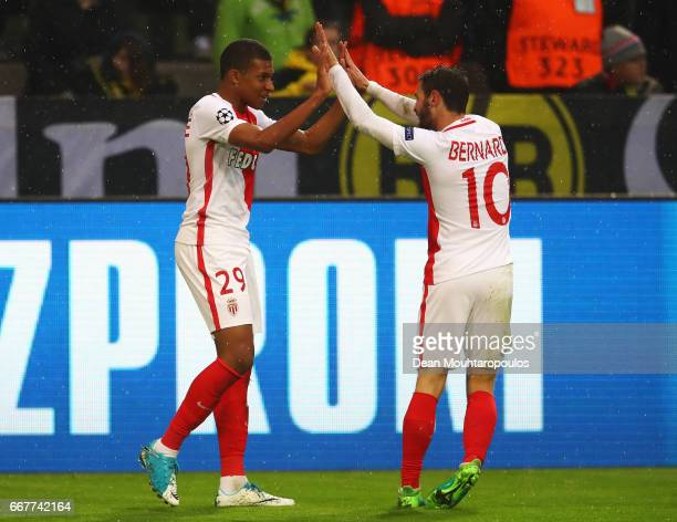 Kylian Mbappe of AS Monaco celebrates with team mate Bernardo Silva after scoring his team's first goal of the game during the UEFA Champions League...