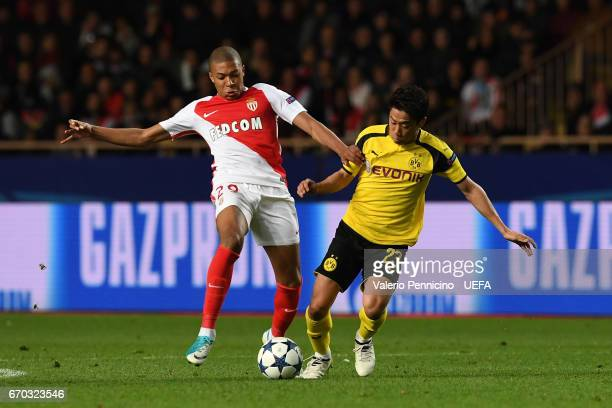 Kylian Mbappe of AS Monaco competes with Shinji Kagawa of Borussia Dortmund during the UEFA Champions League Quarter Final second leg match between...