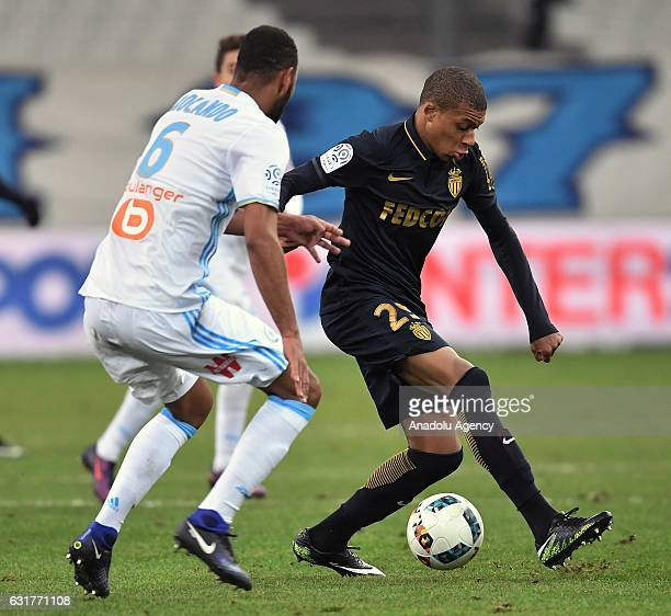 Kylian Mbappe of AS Monaco in action against Jorge Rolando of Olympique de Marseille during the French Ligue 1 football match between Olympique de...