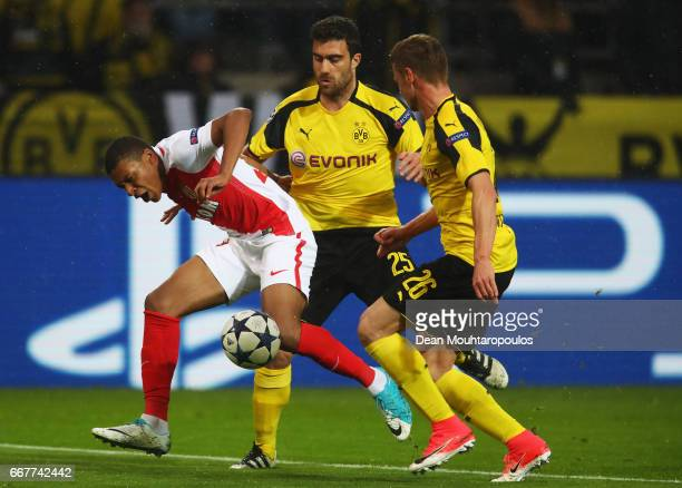 Kylian Mbappe of AS Monaco is fouled by Sokratis Papastathopoulos and Lukasz Piszczek of Borussia Dortmund in the penalty area during the UEFA...