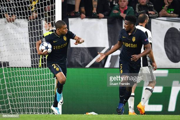 Kylian Mbappe of AS Monaco runs back to the half way line with Jemerson after scoring his sides first goal during the UEFA Champions League Semi...