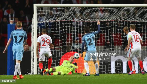 Kylian Mbappe of AS Monaco scores their first goal psst goalkeeper Willy Cabellero of Manchester City during the UEFA Champions League Round of 16...