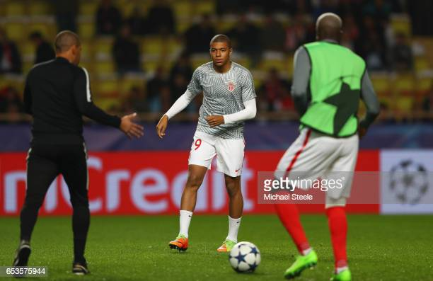 Kylian Mbappe of AS Monaco warms up with team mates prior to the UEFA Champions League Round of 16 second leg match between AS Monaco and Manchester...