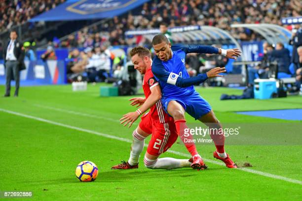 Kylian Mbappe of France and Chris Gunter of Wales during the international friendly match between France and Wales at Stade de France on November 10...