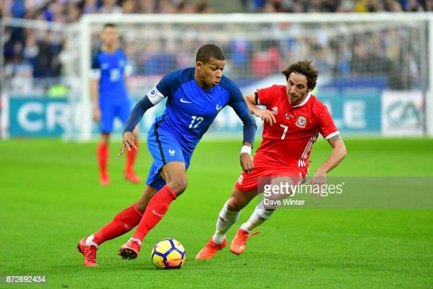 Kylian Mbappe of France and Joe Allen of Wales during the international friendly match between France and Wales at Stade de France on November 10...
