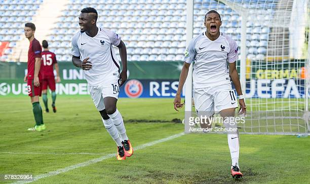 Kylian Mbappe of France celebrates the second goal for his team with Marcus Thuram of France during the U19 match between Portugal and France at...