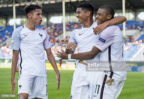 Kylian Mbappe of France celebrates the third goal for his team with Amine Harit of France and JeanKevin Augustin of France during the U19 match...