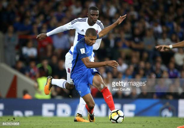 Kylian Mbappe of France Christopher Martins Pereira of Luxembourg during the FIFA 2018 World Cup Qualifier between France and Luxembourg at the...