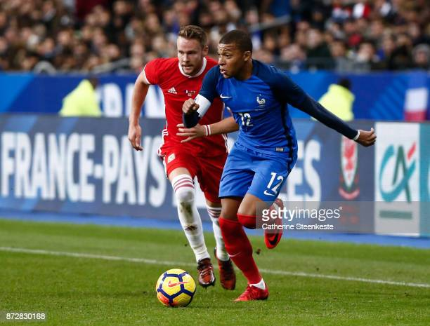 Kylian Mbappe of France controls the ball against Chris Gunter of Wales during the international friendly match between France and Wales at Stade de...