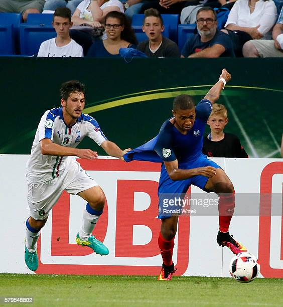 Kylian Mbappe of France is challenged by Davide Vitturini of Italy during the UEFA Under19 European Championship Final match between U19 France and...