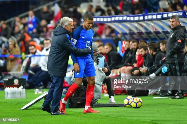 Kylian Mbappe of France is substituted by France coach Didier Deschamps during the international friendly match between France and Wales at Stade de...