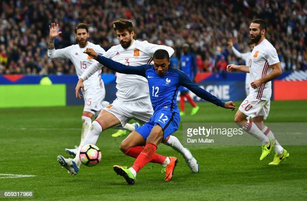 Kylian Mbappe of France misses a chance at goal closed down by Gerard Pique of Spain during the International Friendly match between France and Spain...