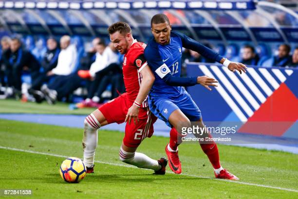 Kylian Mbappe of France tries to control the ball against Chris Gunter of Wales during the international friendly match between France and Wales at...