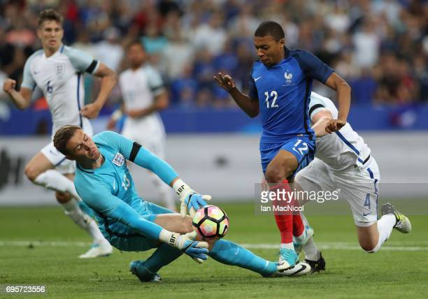 Kylian Mbappe of France vies with Tom Heaton of England during the international Friendly match between France and England at Stade de France on June...