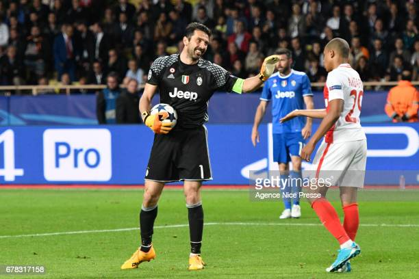 Kylian Mbappe of Monaco and Gianluigi Buffon during the Uefa Champions League match semi final first leg between As Monaco and Juventus FC at Stade...