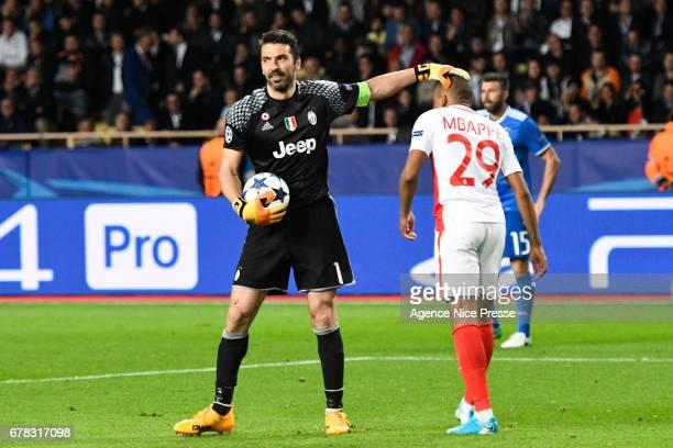 Kylian Mbappe of Monaco and Gianluigi Buffon of Juventus during the Uefa Champions League match semi final first leg between As Monaco and Juventus...