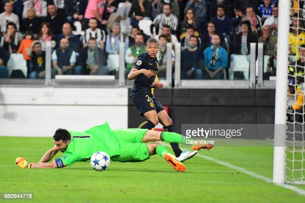 Kylian Mbappe of Monaco and Gianluigi Buffon of Juventus during the Uefa Champions League match semi final second leg between Juventus FC and As...