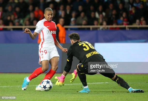 Kylian Mbappe of Monaco and goalkeeper of Dortmund Roman Burki in action during the UEFA Champions League quarter final second leg match between AS...