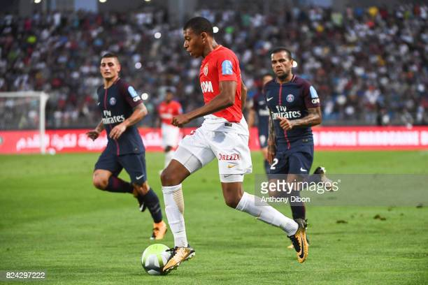 Kylian Mbappe of Monaco and Marco Verratti and Daniel Alves of PSG during the Champions Trophy match between Monaco and Paris Saint Germain at Stade...