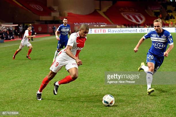 Kylian Mbappe of Monaco and Pierre Bengtsson of Bastia during the Ligue 1 match between AS Monaco and SC Bastia at Louis II Stadium on December 3...
