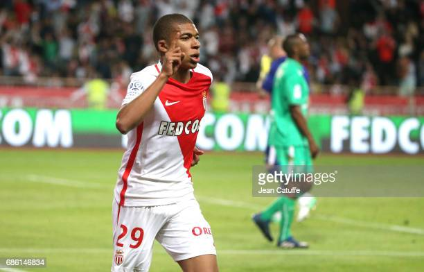 Kylian Mbappe of Monaco celebrates scoring a goal during the French Ligue 1 match between AS Monaco and AS SaintEtienne at Stade Louis II on May 17...