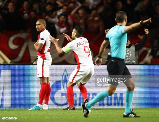 Kylian Mbappe of Monaco is congratulated after scoring the first goal during the UEFA Champions League Quarter Final second leg match between AS...