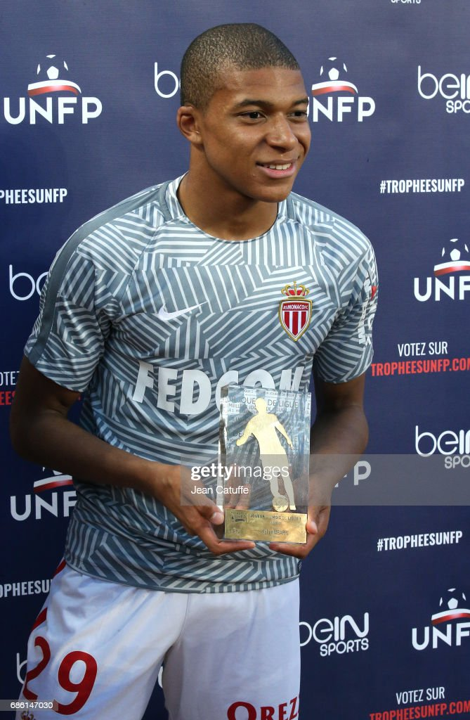 Kylian Mbappe of Monaco receives the trophy of 'best newcomer of the season' before the French Ligue 1 match between AS Monaco and AS Saint-Etienne (ASSE) at Stade Louis II on May 17, 2017 in Monaco, Monaco.