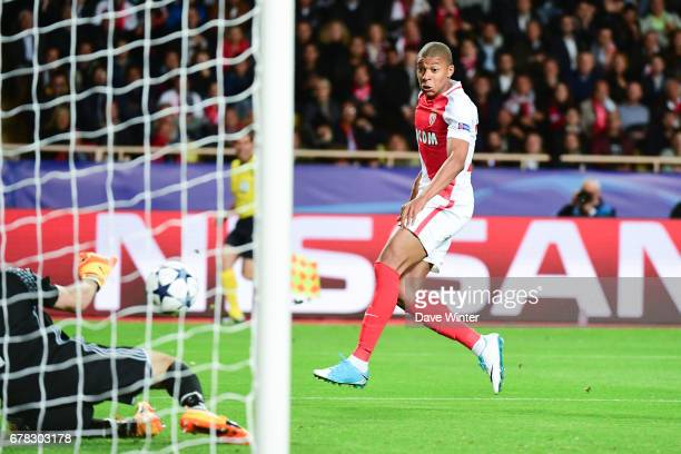 Kylian Mbappe of Monaco sees his shot saved by Gianluigi Buffon of Juventus during the Uefa Champions League match semi final first leg between As...