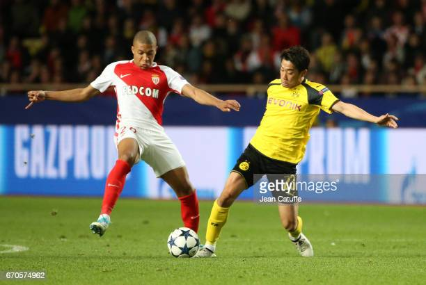 Kylian Mbappe of Monaco Shinji Kagawa of Dortmund during the UEFA Champions League quarter final second leg match between AS Monaco and Borussia...