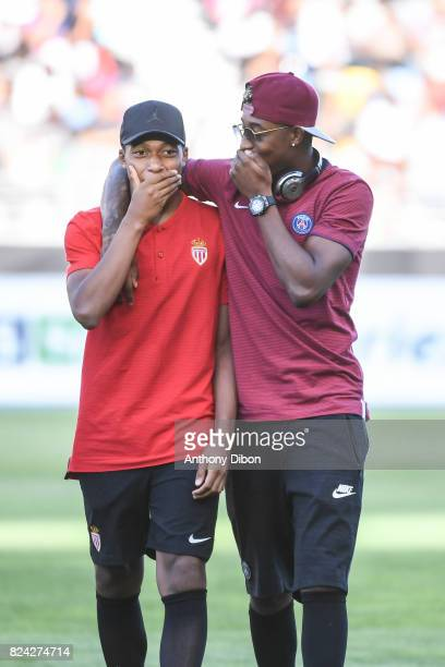 Kylian Mbappe of Monaco talks with Presnel Kimpembe of PSG during the Champions Trophy match between Monaco and Paris Saint Germain at Stade...