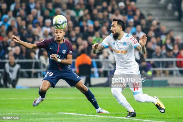 Kylian Mbappe of Paris and Kostas Mitroglou of Marseille during the Ligue 1 match between Olympique Marseille and Paris Saint Germain at Stade...