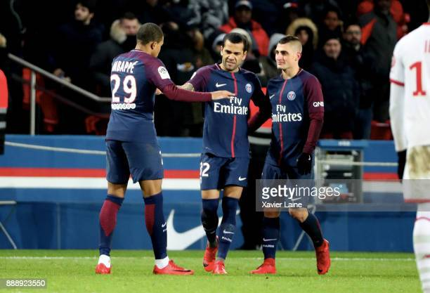 Kylian Mbappe of Paris SaintGermain celebrates his goal with Dani Alves and Marco Verratti during the Ligue 1 match between Paris Saint Germain and...