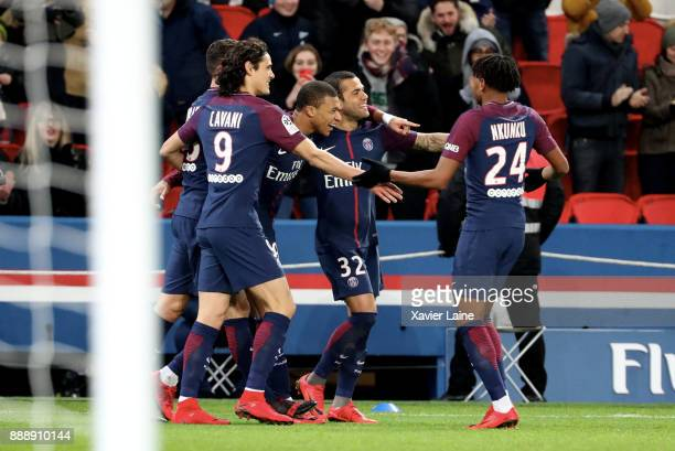 Kylian Mbappe of Paris SaintGermain celebrates his goal with teammates during the Ligue 1 match between Paris Saint Germain and Lille OSC at Parc des...