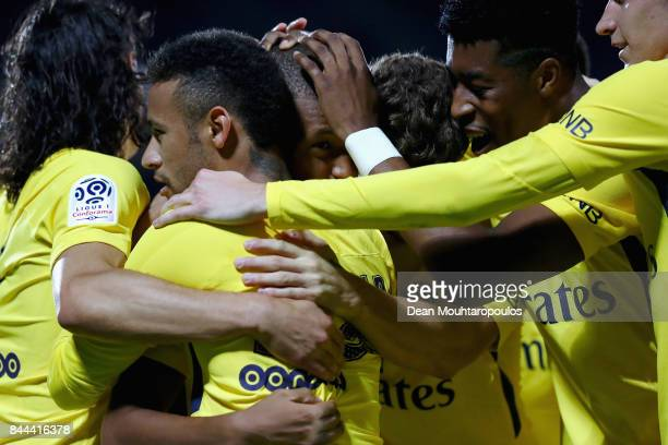 Kylian Mbappe of Paris SaintGermain Football Club or PSG celebrates scoring his teams second goal of the game with team mates during the Ligue 1...