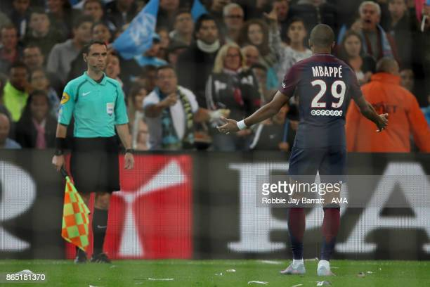 Kylian Mbappe of Paris SaintGermain has a disagreement with the linesman during the Ligue 1 match between Olympique Marseille and Paris Saint Germain...