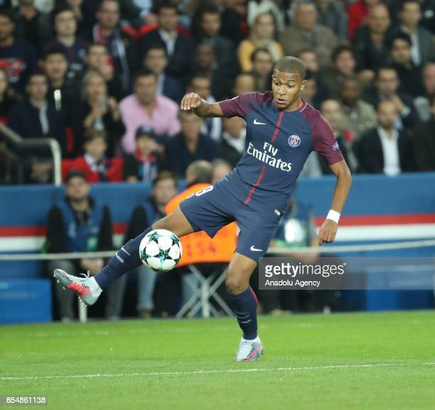 Kylian Mbappe of Paris SaintGermain in action during the UEFA Champions League Group B match between Paris SaintGermain and Bayern Munich at Parc des...